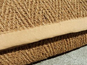 a close up of herringbone weave coir mat